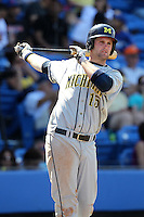 First baseman Garrett Stephens #15 of the Michigan Wolverines vs the New York Mets in an exhibition game at Digital Domain Ballpark in Port St Lucie, Florida;  February 27, 2011.  New York defeated Michigan 7-1.  Photo By Mike Janes/Four Seam Images