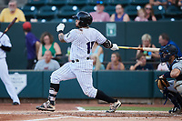 Harvin Mendoza (17) of the Winston-Salem Dash follows through on his swing against the Hudson Valley Renegades at Truist Stadium on August 28, 2021 in Winston-Salem, North Carolina. (Brian Westerholt/Four Seam Images)