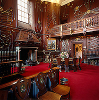 Blair Atholl's great panelled entrance hall is decorated with weapons and hunting trophies
