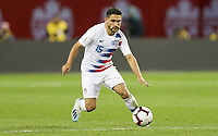 TORONTO, ON - OCTOBER 15: Cristian Roldan #15 of the United States dribbles with the ball during a game between Canada and USMNT at BMO Field on October 15, 2019 in Toronto, Canada.