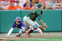 Catcher Garrett Kennedy #40 fields the throw as Steve Wilkerson slides in to score during a  game against the Clemson Tigers at Doug Kingsmore Stadium on March 31, 2012 in Clemson, South Carolina. The Tigers won the game 3-1. (Tony Farlow/Four Seam Images).