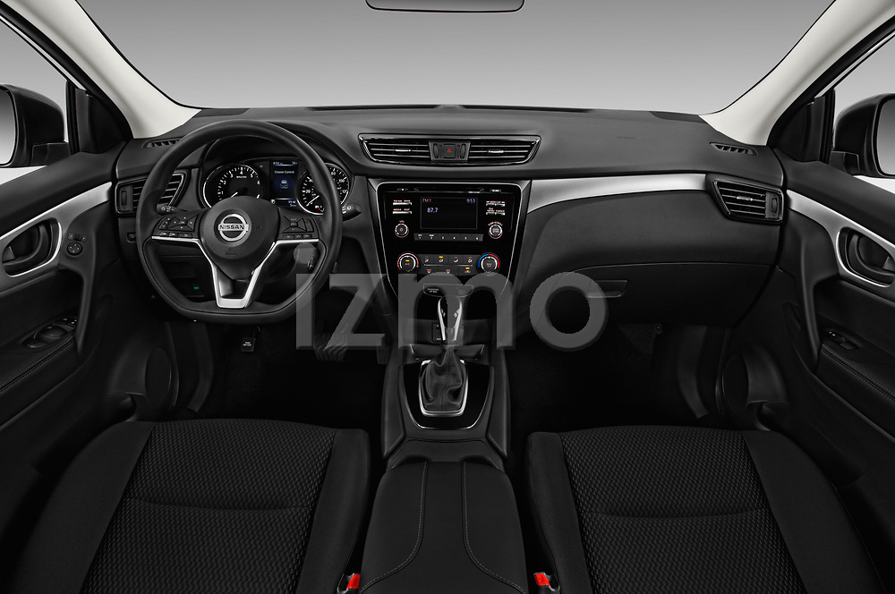 Stock photo of straight dashboard view of a 2018 Nissan Rogue Sport S 4WD 5 Door SUV