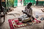 CAR, Bangui: a member of the auto-defense just finish his prayer in the headquarter of the auto-defense PK5. 14th April 2016<br /> <br /> RCA, Bangui : un membre de l'auto-défense du PK5 vient de terminer sa prière. 14 avril 2016