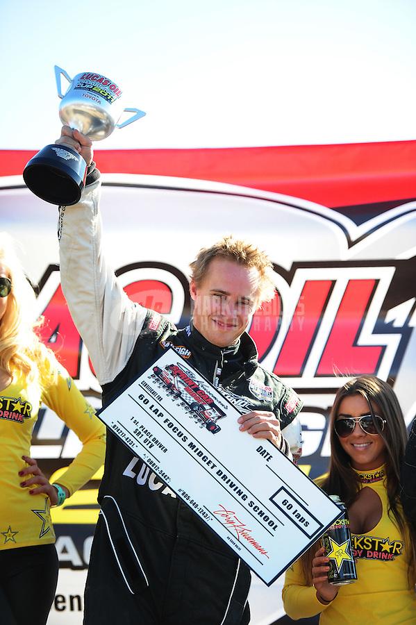 Dec. 11, 2011; Chandler, AZ, USA;  LOORRS UTV driver Ryan Beat after winning the Lucas Oil Challenge Cup at Firebird International Raceway. Mandatory Credit: Mark J. Rebilas-
