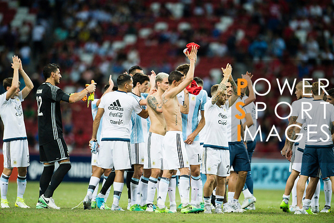 The Argentina squad celebrate after winning the match during the International Test match between Argentina and Singapore at National Stadium on June 13, 2017 in Singapore. Photo by Marcio Rodrigo Machado / Power Sport Images