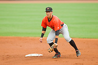 Frederick Keys second baseman Jerome Peña (2) checks the runner at first base during the Carolina League game against the Winston-Salem Dash at BB&T Ballpark on July 21, 2013 in Winston-Salem, North Carolina.  The Dash defeated the Keys 3-2.  (Brian Westerholt/Four Seam Images)