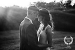 A bride and groom embrace during the golden hour after their ceremony at Tappan Hill Mansion in Tarrytown, New York.
