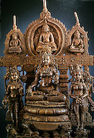India: A Buddhist Altarpiece, c. 800. Madhya Pradesh, bronze inlaid with silver and copper, 15 in.,  cast in several pieces. Perhaps Chunda, Goddess of Wisdom and on right with Lotus, the Goddess Tara. At top, Buddha Amitash flanked by Bodhisattvas.