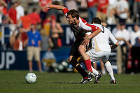Louisville's Colin Rolfe (9) moves past Akron's Chad Barson (3). 2010 NCAA D1 College Cup Championship Final Akron defeated Louisville 1-0 at Harder Stadium on the campus of UCSB in Santa Barbara, California on Sunday December 12, 2010.