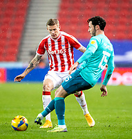2nd January 2021; Bet365 Stadium, Stoke, Staffordshire, England; English Football League Championship Football, Stoke City versus Bournemouth; Adam Smith of Bournemouth crosses the ball in front of James McClean of Stoke City