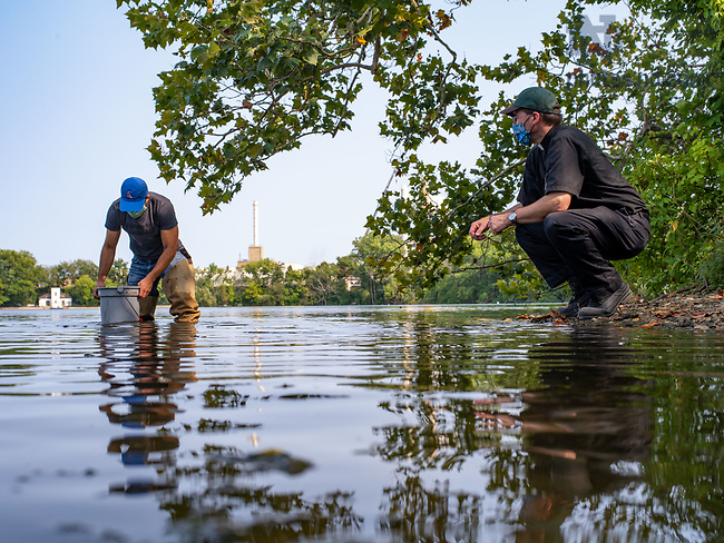 September 16, 2020; Rev. Terry Ehrman, C.S.C., right, instructs a student in his aquatic biology class in collecting water samples from  St. Joseph Lake. (Photo by Matt Cashore/University of Notre Dame)