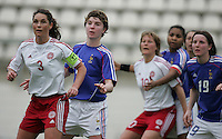 MAR 9, 2006: Faro, Portugal:  French forward (11) Laettitia Tonazzi and Danish defender (3) Katrine Pedersen watch a corner kick come in the box  at the Algarve Cup in Faro, Portugal. Mandatory Credit: Photo By Brad Smith-International Sports Images.