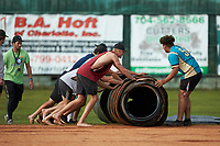 Members of the Mooresville Spinners help roll up the tarp prior to the exhibition game against the Race City Bootleggers at Moor Park on July 23, 2020 in Mooresville, NC. (Brian Westerholt/Four Seam Images)