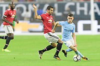 Houston, TX - Thursday July 20, 2017: Henrikh Mkhitaryan and Phil Foden during a match between Manchester United and Manchester City in the 2017 International Champions Cup at NRG Stadium.