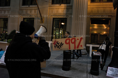 Chicago, Illinois<br /> October 3, 2011<br /> <br /> Demonstrators take part in a night protest at Occupy Chicago protests outside the Bank of America building and the Reserve Bank. The protest is one of many around the country held in solidarity with the Occupy Wall Street protests currently taking place in New York City.