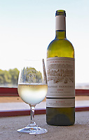 Glass of white wine with the text Chateau Vannieres and a bottle of white wine Chateau Vannieres (Vannières) La Cadiere (Cadière) d'Azur Bandol Var Cote d'Azur France