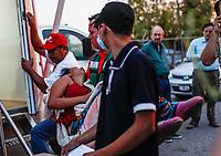 """Medicos y paramedics atiende a una joven que surgió un colapso en el Comedor Comunitario. <br /> <br /> Migrantes reciben atención medica, alimentación, aseo personal y un lugar para descansar en el comedor Comunitario de la Colonia San Luis de Hermosillo Sonora.<br /> <br /> La Caravana del Migrante con un contingente de alrededor de 600 personas en su mayoría de origen centroamericano, arribo a Hermosillo Sonora a bordo del tren conocido como """"La Bestia"""", provienen de la frontera Sur del País y con rumbo a la ciudad de Mexicali donde continuaran el viaje hasta Tijuana.<br /> La caravana tiene como objetivo solicitar <br /> asilo a Estados Unidos y algunos integrantes piensan solicitar una visa humanitaria en México para laborar en los campos de Sonora y Baja California.<br /> (Photo: NortePhoto/Luis Gutiérrez)"""