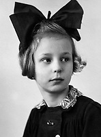 BNPS.co.uk (01202 558833)<br /> Pic: WillemienRieken/BNPS<br /> <br /> Willemien aged 8 during the war.<br /> <br /> Arnhem flowergirl finally honoured - Willemien was suprised to be presented with flowers and a certificate by Parachute Regiment veterans at the weekend.<br /> <br /> A Dutch woman who has tended to the grave of a British paratrooper killed at the Battle of Arnhem for 75 years has been presented with flowers from his regiment as a token of their gratitude.<br /> <br /> Every year Willemien Rieken, 84, lays flowers at Oosterbeek War Cemetery in memory of Trooper William Edmond who was shot by a German sniper after landing in Holland in World War Two.<br /> <br /> She was surprised at his grave by a member of Tpr Edmond's 1st Airborne Reconnaissance Squadron at a ceremony marking the 75th anniversary of the battle.