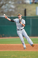 Coastal Carolina Chanticleers shortstop Nick Oberg (16) makes a throw to first base on the run against the High Point Panthers at Willard Stadium on March 14, 2014 in High Point, North Carolina.  The Panthers defeated the Chanticleers 3-0.  (Brian Westerholt/Four Seam Images)