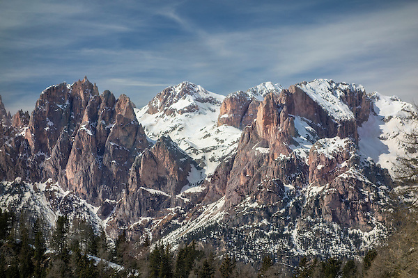 Italy, Dolomites.  <br /> A pleasant landscape that works (mostly) because of a dramatic mountain bathed in warm light, with a nice sky. Maybe it needs some foreground to take it to the next level?  <br /> View from Cianpac Ski Area above Val di Fassa, near Canazei, Italian Dolomites.