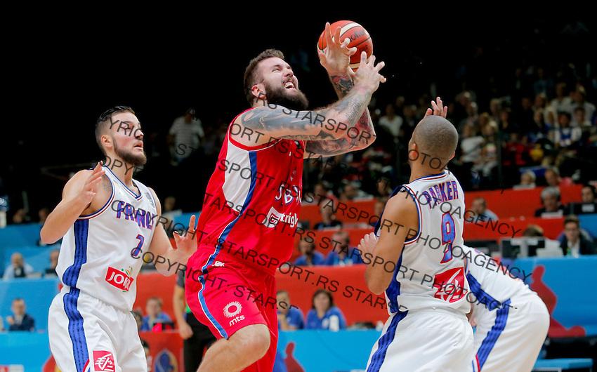 France's Tony Parker (L) vies with Serbia's Miroslav Raduljica (R) during European championship basketball match for third place between France and Serbia on September 20, 2015 in Lille, France  (credit image & photo: Pedja Milosavljevic / STARSPORT)