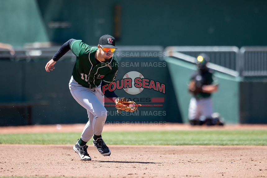 Great Lakes Loons third baseman Miguel Vargas (11) fields a ground ball on May 30, 2021 against the Lansing Lugnuts at Jackson Field in Lansing, Michigan. (Andrew Woolley/Four Seam Images)