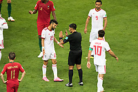 SARANSK, RUSSIA - June 25, 2018: Iran's Ramin Rezaeian is talked to by referee Enrique Caceres during their 2018 FIFA World Cup group stage match against Portugal at Mordovia Arena.