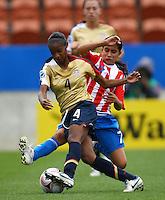 Crystal Dunn (USA) and Rebeca Fernandez (PAR)..FIFA U17 Women's World Cup, Paraguay v USA, Waikato Stadium, Hamilton, New Zealand, Sunday 2 November 2008. Photo: Renee McKay/PHOTOSPORT