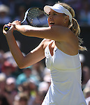 June 24, 2009.Maria Sharapova of Russia, in action during her 6-2, 4-6, 6-3 loss to Gisela Dulko of Argentina in the second round at the All England Lawn Tennis Club, Wimbledon, England