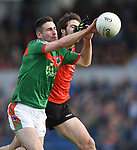 Niall Hickey of Kilmurry Ibrickane in action against James Morphy of Clondegad during their senior county final at Cusack park. Photograph by John Kelly.