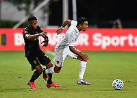 LAKE BUENA VISTA, FL - JULY 18: Julian Araujo #22 of LA Galaxy is pressured by Diego Palacios #12 of LAFC during a game between Los Angeles Galaxy and Los Angeles FC at ESPN Wide World of Sports on July 18, 2020 in Lake Buena Vista, Florida.