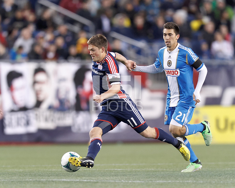 New England Revolution midfielder Kelyn Rowe (11) brings the ball forward as Philadelphia Union midfielder Michael Farfan (21) closes.In a Major League Soccer (MLS) match, the New England Revolution (blue/red) defeated Philadelphia Union (blue/white), 2-0, at Gillette Stadium on April 27, 2013.