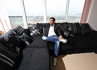 Pictured: The all new look Chico Flores, footballer for Swansea City FC, in his Swansea apartment, south Wales. Tuesday 02 April 2014