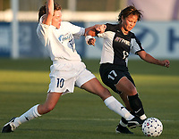 Hege Riise of the Carolina Courage tackles the ball from Ronnie Fair of the NY Power. The Courage defeated the Power 2-1 on Wednesday August 7th at Mitchel Athletic Complex, Uniondale, NY.