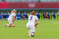 TOKYO, JAPAN - JULY 22: Kelley O'Hara #5 of the United States takes the knee before a game between Sweden and USWNT at Tokyo Stadium on July 22, 2021 in Tokyo, Japan.