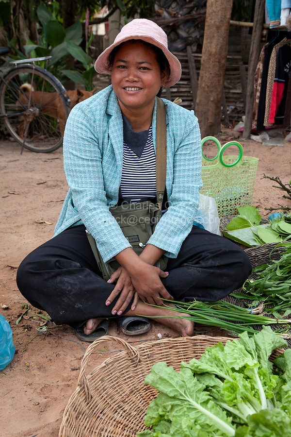 Cambodia.  Woman Selling Onions and Lettuce, Market near Siem Reap.