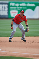 Dusty Coleman (9) of the El Paso Chihuahuas on defense against the Salt Lake Bees at Smith's Ballpark on July 8, 2018 in Salt Lake City, Utah. El Paso defeated Salt Lake 15-6. (Stephen Smith/Four Seam Images)