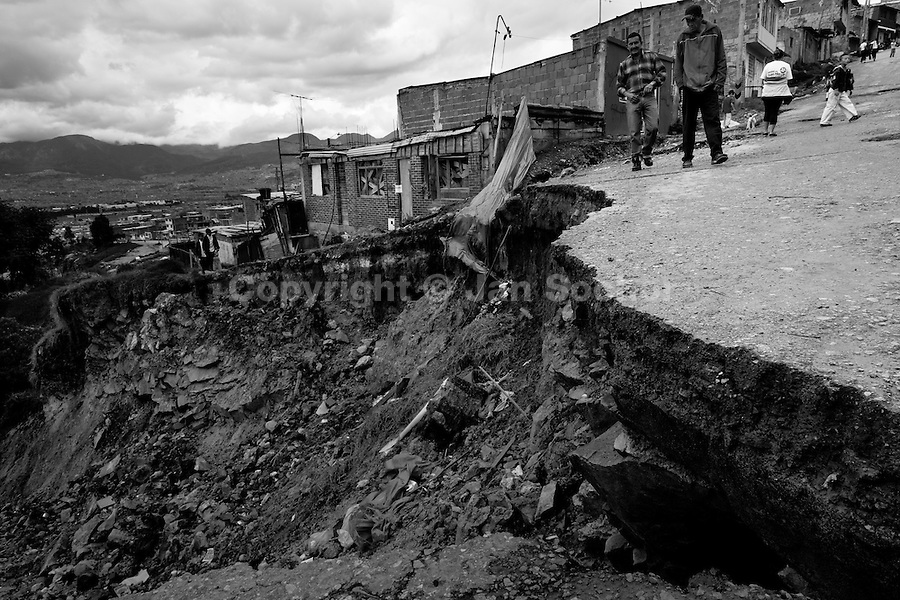 A massive landslide in Ciudad Bolívar, a shanty town in the south of Bogota, where internally displaced people from all over the country live, Colombia, 25 May 2010. With nearly fifty years of armed conflict, Colombia has the highest number of civil war refugees in the world. During the last ten years of the civil war more than 3 million people have been forced to abandon their lands and to leave their homes due to the violence. Internally displaced people (IDPs) come from remote rural areas, where most of the clashes between leftist guerrillas FARC-ELN, right-wing paramilitary groups and government forces takes place. Displaced persons flee in a hurry, carrying just personal belongings, and thus they inevitably end up in large slums of the big cities, with no hope for the future.
