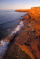 Prince Edward Island National Park, Canada, Prince Edward Island, P.E.I., Gulf of St. Lawrence, Golden light on sandstone cliffs at sunset along Cavendish Beach in Prince Edward Island National Park on Prince Edward Island.