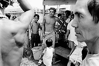 Philippines. Luzon island. San Fernando, Pampanga.70 km from Manila. Flagellation at Easter on Good Friday. A group of men stripped to the waist gets ready for the flagellation procession.  © 1999 Didier Ruef