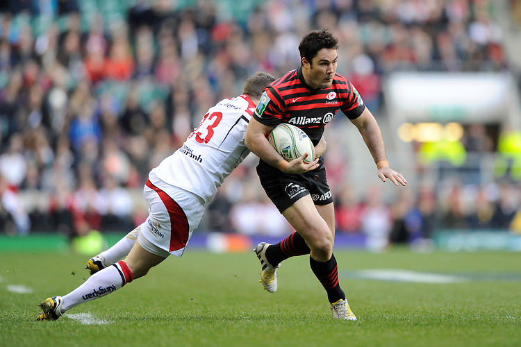 Brad Barritt of Saracens is tackled by Darren Cave of Ulster Rugby during the Heineken Cup quarter final match between Saracens and Ulster Rugby at Twickenham Stadium on Saturday 6th April 2013 (Photo by Rob Munro)