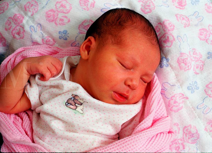 Infant child sleeps.