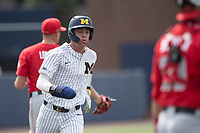 Michigan Wolverines shortstop Benjamin Sems (2) scores a run during NCAA baseball action against the Ohio State Buckeyes on April 10, 2021 at Ray Fisher Stadium in Ann Arbor, Michigan. The Wolverines defeated the Buckeyes 7-0. (Andrew Woolley/Four Seam Images)