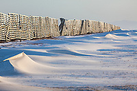 Snow drifts at the snow fence on the edge of town in Kaktovik, Barter Island, Arctic, Alaska.