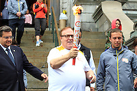 President of the Canadian Olympic Committee Marcel Aubut carrying the Olympic torch while wearing shorts,<br /> with Montreal mayor Denis Coderre (L) at City Hall, June 28, 2015.,<br /> <br /> Aubut resigned as President of the COC on October 3, 2015 after allegations of sexual harassment.<br /> <br /> PHOTO : Pierre Roussel - Agence Quebec Presse