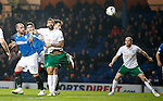 Kris Boyd attacks the ball before Liam Fontaine