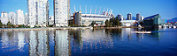 Vancouver, BC, British Columbia, Canada - Downtown City Skyline at False Creek with BC Place Stadium (New Retractable Roof completed in 2011), Rogers Arena, and Edgewater Casino - Panoramic View
