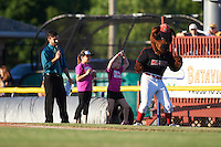 "Batavia Muckdogs mascot Homer dances with young fans during an the field promotion ""Dance for your Dinner"" in between innings during a game against the West Virginia Black Bears on June 29, 2016 at Dwyer Stadium in Batavia, New York.  West Virginia defeated Batavia 9-4.  (Mike Janes/Four Seam Images)"