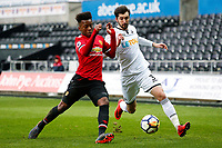 Sunday 18 March 2018<br /> Pictured:  Ethan Laird of Manchester United is challenged by Matic Paljk of Swansea City<br /> Re: Swansea City v Manchester United U23s in the Premier League 2 at The Liberty Stadium on March 18, 2018 in Swansea, Wales.