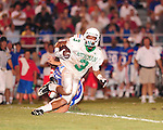 Odell Beckham of Newman carries the ball during their 34-7 loss to the John Curtis Patriots.